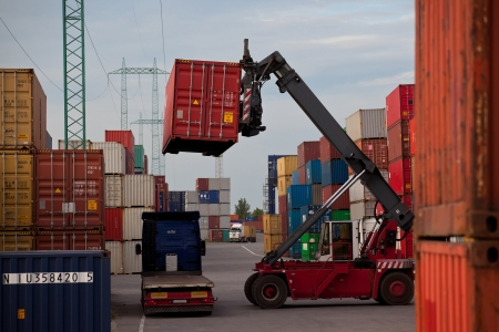 containers: Container forklift loading m the truck Editorial