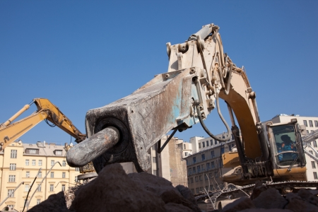 dismantling: Detail of hydraulic hammer at excavator arm Stock Photo