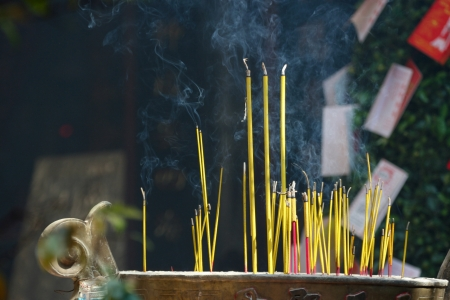Smoking prayer sticks at asia pagoda photo