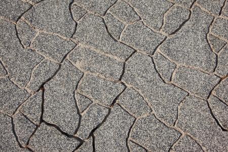 Texture of irregular concrete pavement photo
