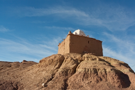 Kasbah- Fortified house in north African desert photo