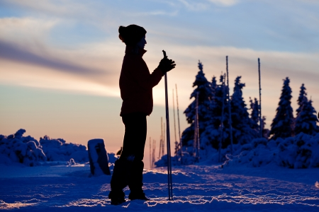 Sunset silhouette of cross country skier photo