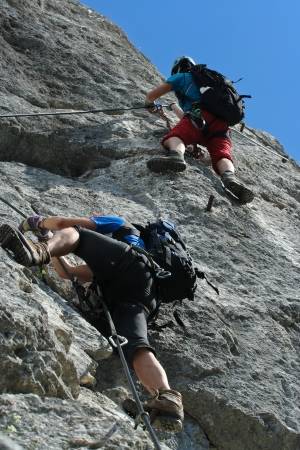 Two klettersteig climbers at steep wall Stock Photo