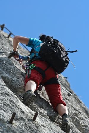 securing: Women climber securing at via ferrata Stock Photo