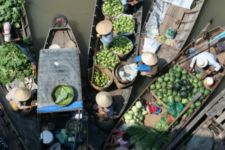 Vegetable merchants at Mekong floating market photo