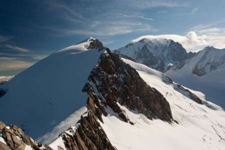 capped: Snow covered mountain ridge at Mont Blanc massive Stock Photo
