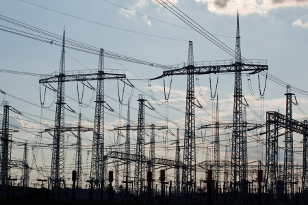 amp tower: Many crossing electric power transmission lines