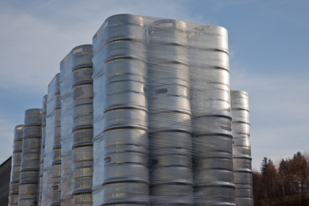 Beer barrels in a stack - preparing to transportation Stock Photo