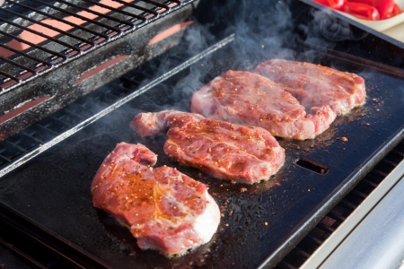 sizzling: Meat  sizzling on the BBQ Stock Photo