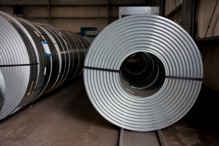 Rows of steel plate coils Stock Photo
