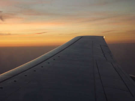 View from the airplane window at the start of the sunset over Prague photo