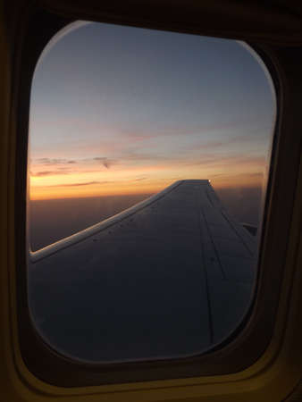 View from the airplane window at the start of the sunset over Prague Stock Photo - 24361371