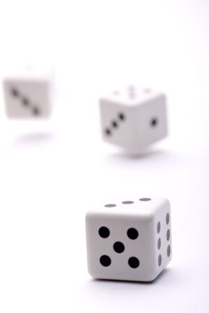 three dice thrown into the air trying their luck