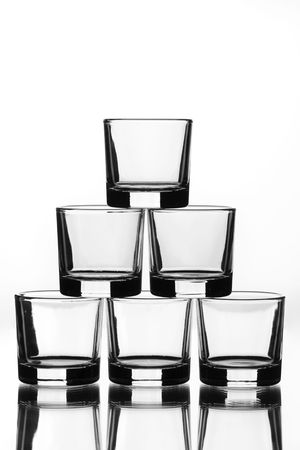 six small glasses placed in a pyramid photo