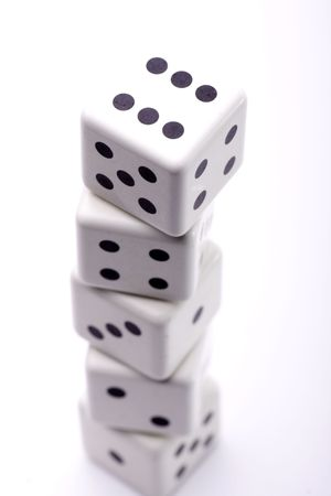 tower consists of five dice with different numbers Stock Photo