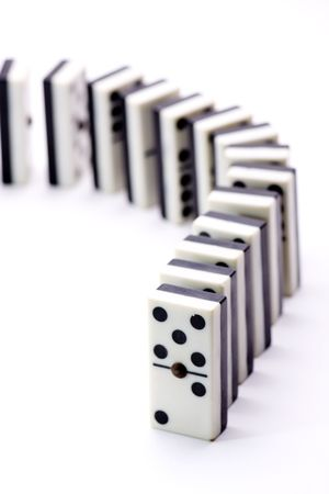 many dominoes lined up in a curve