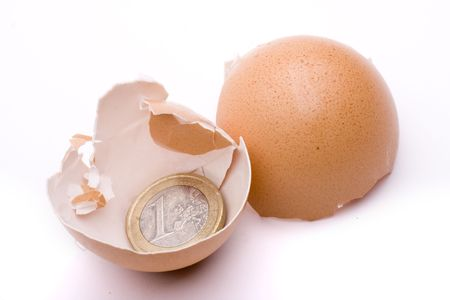 the coat of an egg broken into a euro Stock Photo