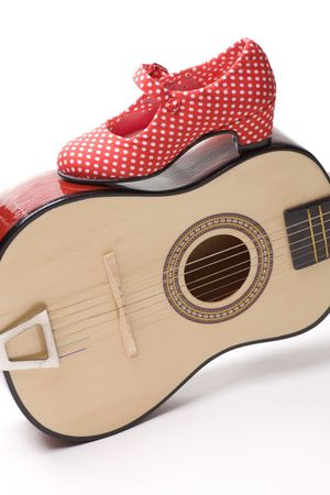 Spanish guitar and red shoes to dance flamenco photo