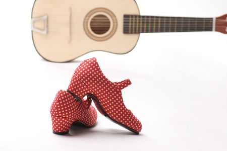 shoes of a flamenco dancer with a guitar in the background photo