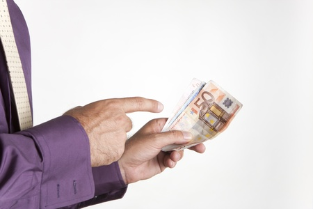 a man paying his debts with euro banknotes Banque d'images