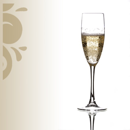 a glass of champagne surrounded by an ornament