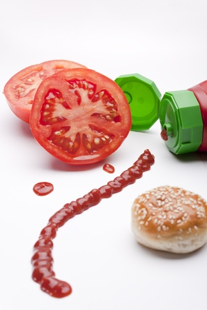 a tomato and a bottle of ketchup