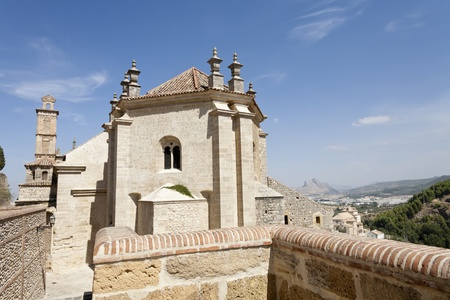 a centuries-old church, and behind the mountains Stock Photo