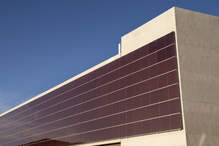 a building with hundreds of solar panels on the facade