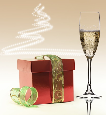 a gift and a glass of champagne to celebrate Christmas Stock Photo
