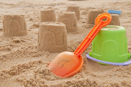 shovel in the sand on the beach