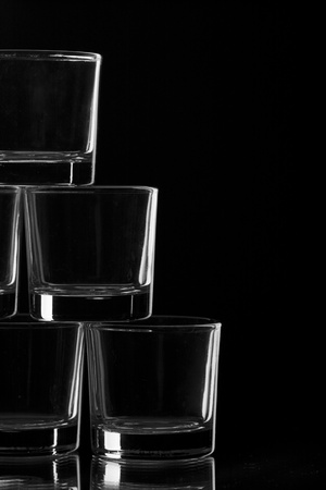 glasses of liquor on a black background photo