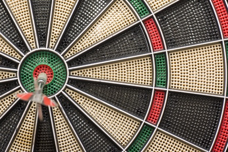 a good shot of a dart at a target Stock Photo
