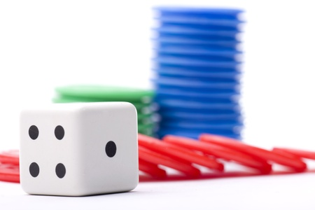 tokens: dice surrounded by colored tokens won in a casino Stock Photo