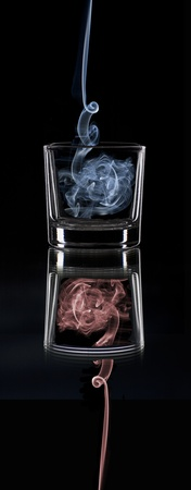 a smoke-filled glass in a mirror photo