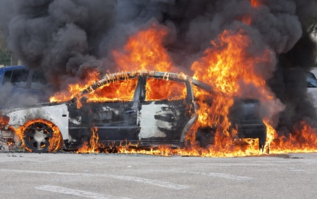 a burning car after a serious accident Stock Photo