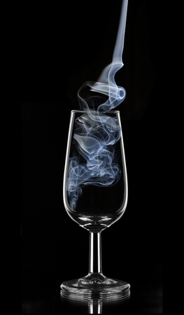 blue smoke in a glass of sherry