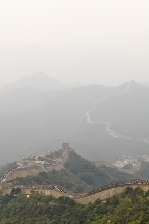 the Great Wall of China behind a huge fog photo