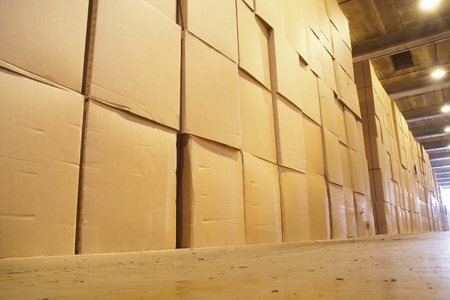 hundreds of boxes stored in a huge warehouse Stock Photo