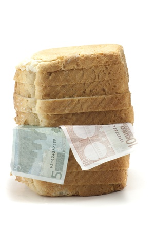 euro banknotes in a loaf of bread Stock Photo