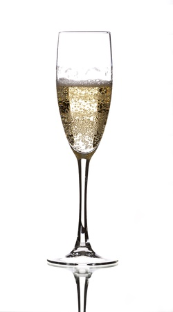 a glass of champagne filled with lots of bubbles Banque d'images