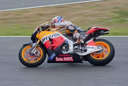 gp: Moto GP rider Casey Stoner running at Jerez