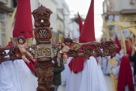 semana santa: penitents accompanying Jesus and the Virgin in procession Editorial