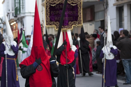 semana santa: penitents of various brotherhoods, accompanying Christ in the procession of the Santo