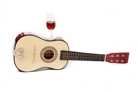 a Spanish guitar, and a glass of wine, two typical symbols of Spain Stock Photo