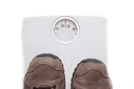 kilograms: a person weighing themselves to know how many kilograms weight