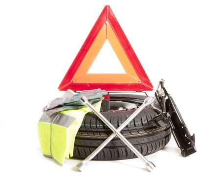a spare wheel and all the tools necessary to change