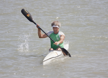 PUERTO REAL, JUNE 09: Arrival of an unidentified canoeist in the veterans category in the championship race canoes Andalucia. June 09, 2012 in Puerto Real, C�diz (Spain)