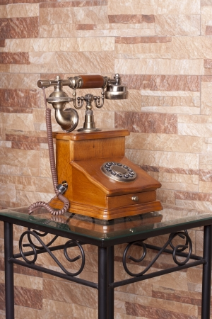 an old telephone, built in wood and metal Stock Photo - 14125218