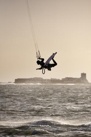 oct 31: CADIZ, ESPA�A - 31 de octubre: surfista desconocido haciendo un truco dif�cil en las aguas de la bah�a de C�diz, donde decenas de fans se re�nen. 31 de octubre 2010 en C�diz (Espa�a) Editorial