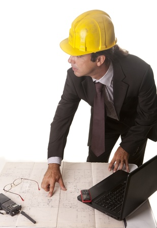 an architect in his office preparing the work plans Stock Photo - 14603104